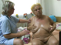 Older woman using sextoy on chubby granny