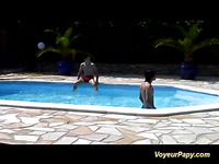 After watching throughout binoculars a pool threesome and masturbating, Papy makes a decision to join the chick and the two studs.