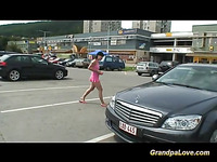 This wicked sweetheart in sexy outfit picks up an older boy-friend in the parking and suggests her services for some coins.