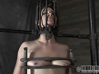 Caged beauty gets a lusty whipping for her smooth wazoo