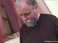 Curious youthful chick gives a oral stimulation to an old avid guy