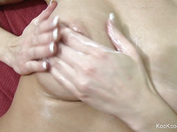 Blond Jenny rubs lotion all over her sexy large milk cans