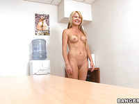 Stunning blonde Jenny Hamilton is taking off her dress indoors