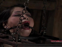 Badly behaved sex Asian chick has been put in the small cage with mouth shut