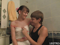 Teen age dude is having sex with this whore in the bathroom