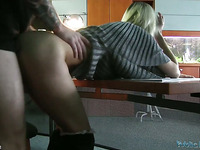 Naughty Nancy gives explicit blowjob at the office