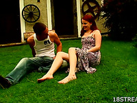 Redhead lady copulates on the grass