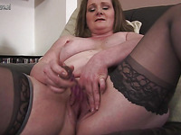 Fine lady is showing off her huge boobs in a very dirty way