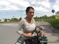 On the roads edge, this erotic dame shows her huge cans to the chap that pays to watch and touch 'em.