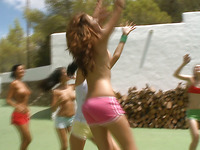 These young and vulgar babes with nice asses are playing outdoors