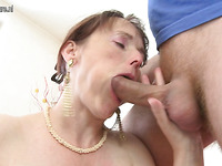 Fierce mature lady is blowing this very fat and tasty boner