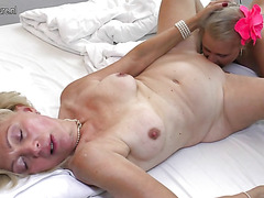 Teen fabulous beauty is having sex with a blonde mature lady