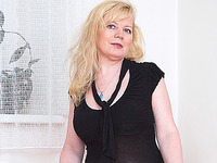 This aged lady with huge tits is flashing them and is masturbating